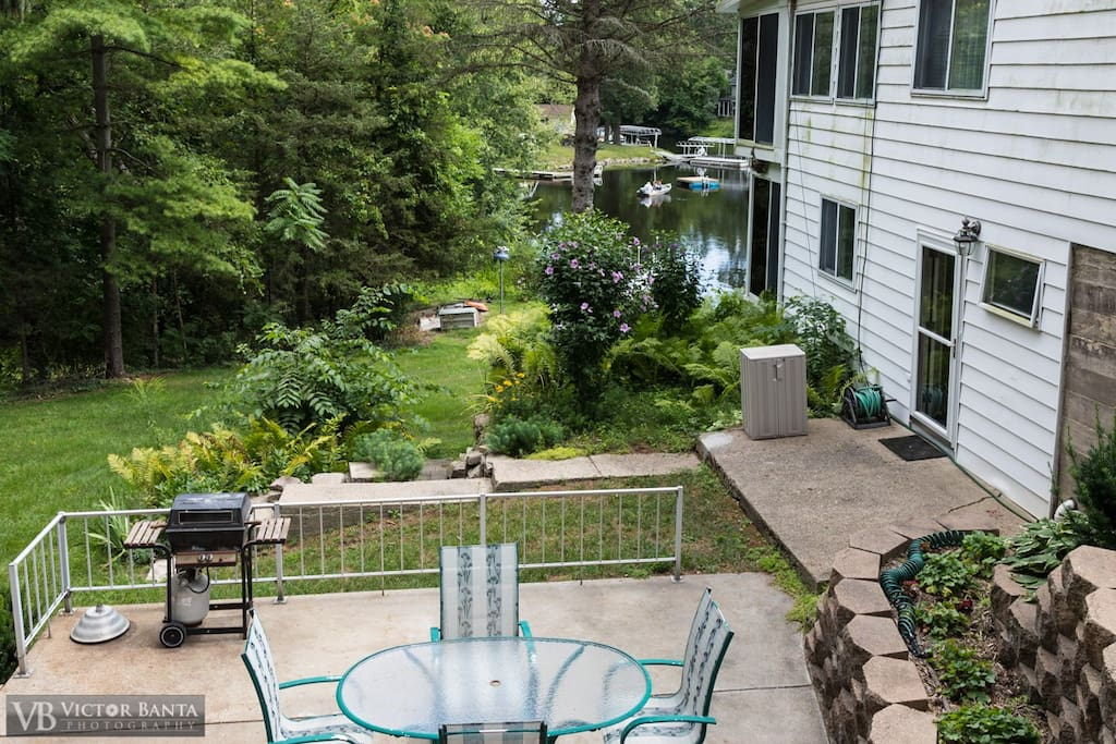 Lower Patio overlooking lake and woods. With table and 4 chairs + propane BBQ.