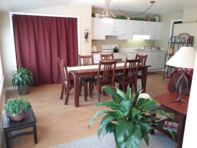 Dining/kitchen area with computer work area behind the curtain.