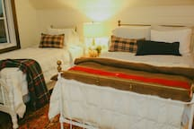 Loft area with twin and double bed.