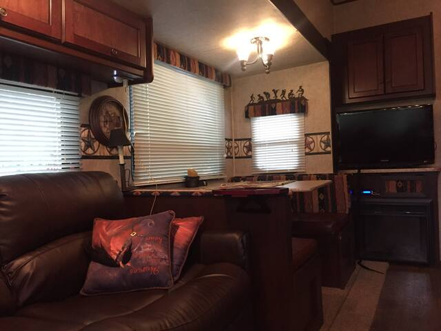 Watch Tv from recliners with indoor fireplace for winter, eating area