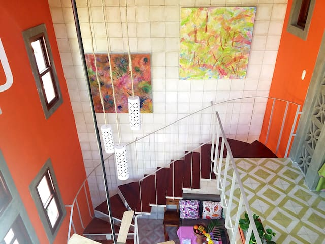 Iron and wood stairs (not suitable for very young children).  Vibrant artwork and colors create a modern and relaxed space.