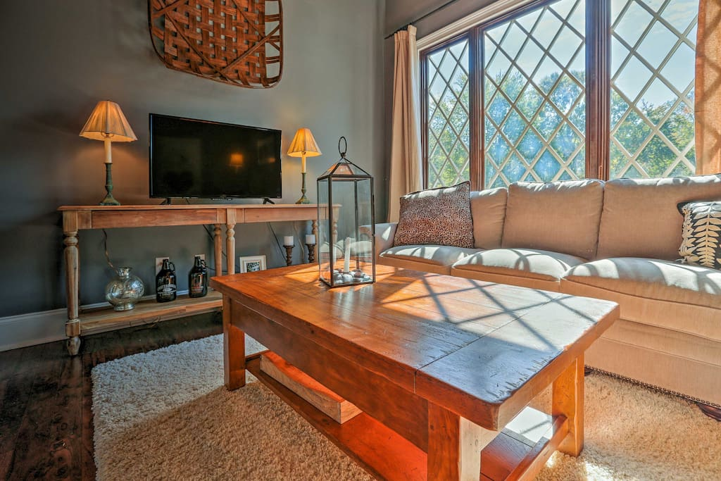 This guest suite boasts hardwood floors and an abundance of natural light.