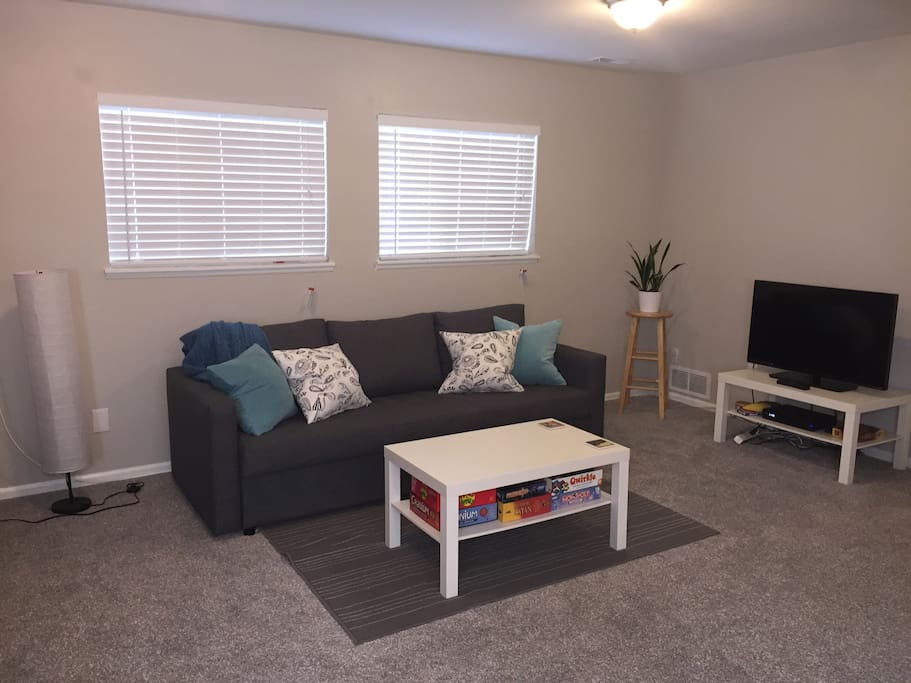 Spacious living area with sofa bed, games, Xfinity TV