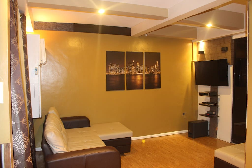 Side view of living room #2. Shows the TV that also includes speakers.