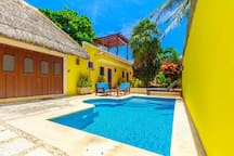 All rooms open to the pool/garden area.