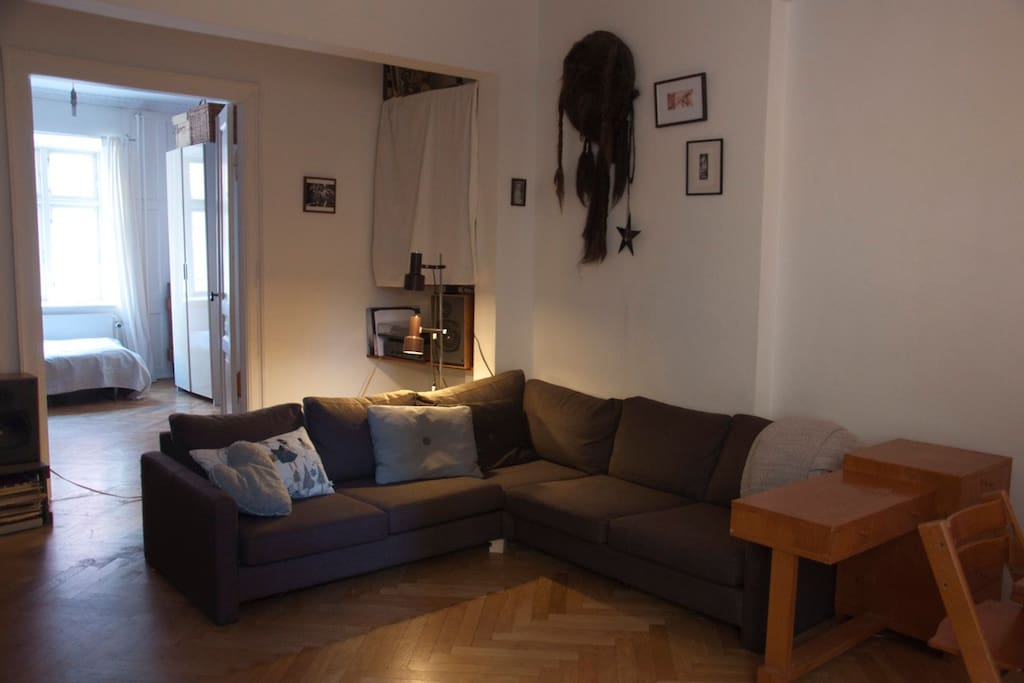 Our spacious living room is the heart of the apartment. This is where we dine and relax.