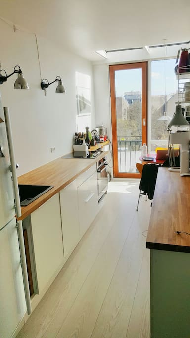 Kitchen with glass extension/balcony