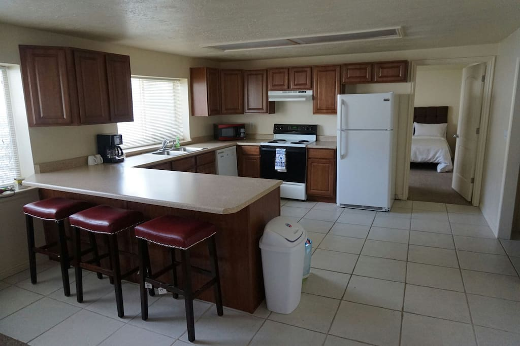Full kitchen with refrigerator, stove, dishwasher, toaster and coffee maker.