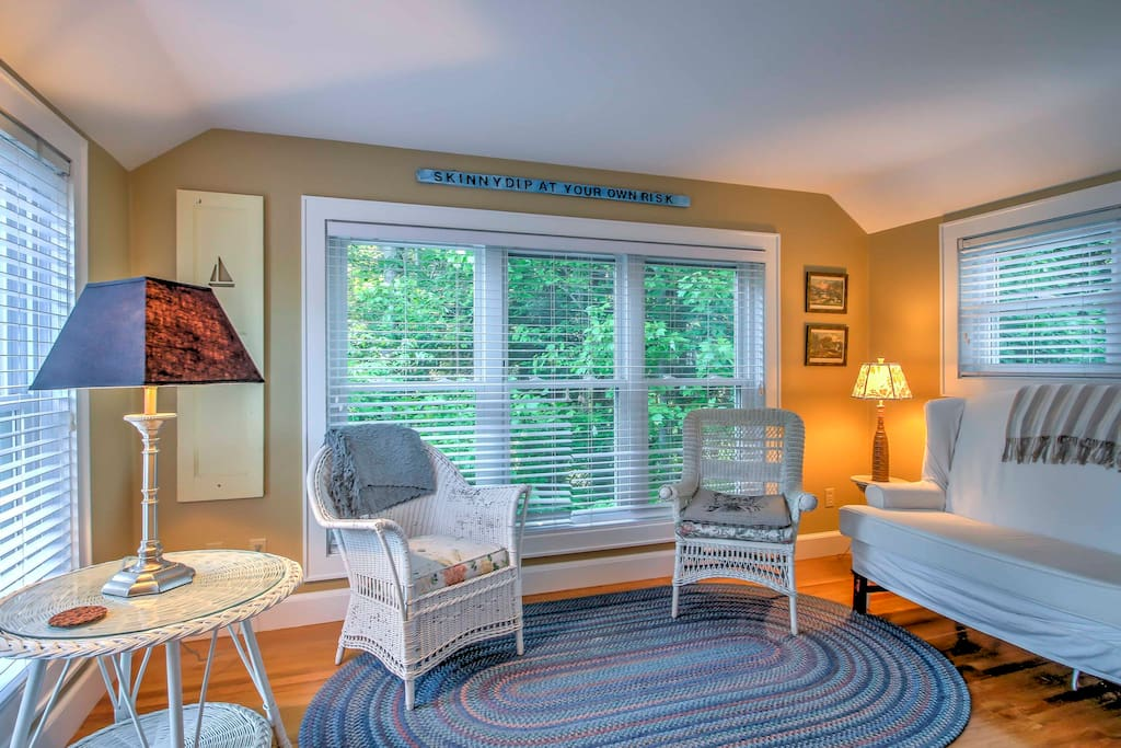 The sunroom in this 2-bedroom, 1-bathroom vacation rental guest house in Kennebunk is the perfect place to relax during your getaway!