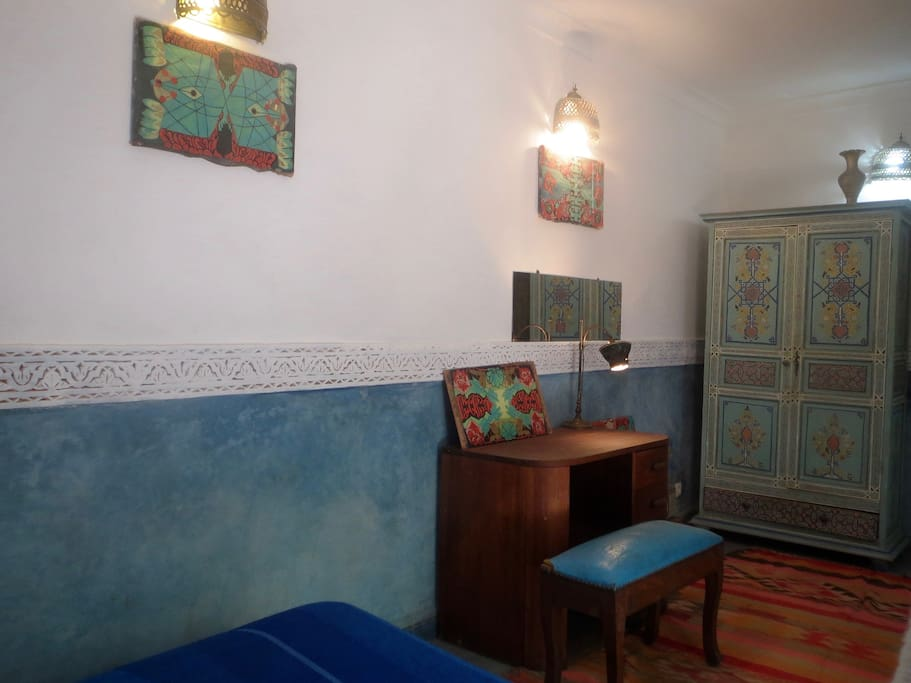 The Blue room features a polyptych by the riad manager