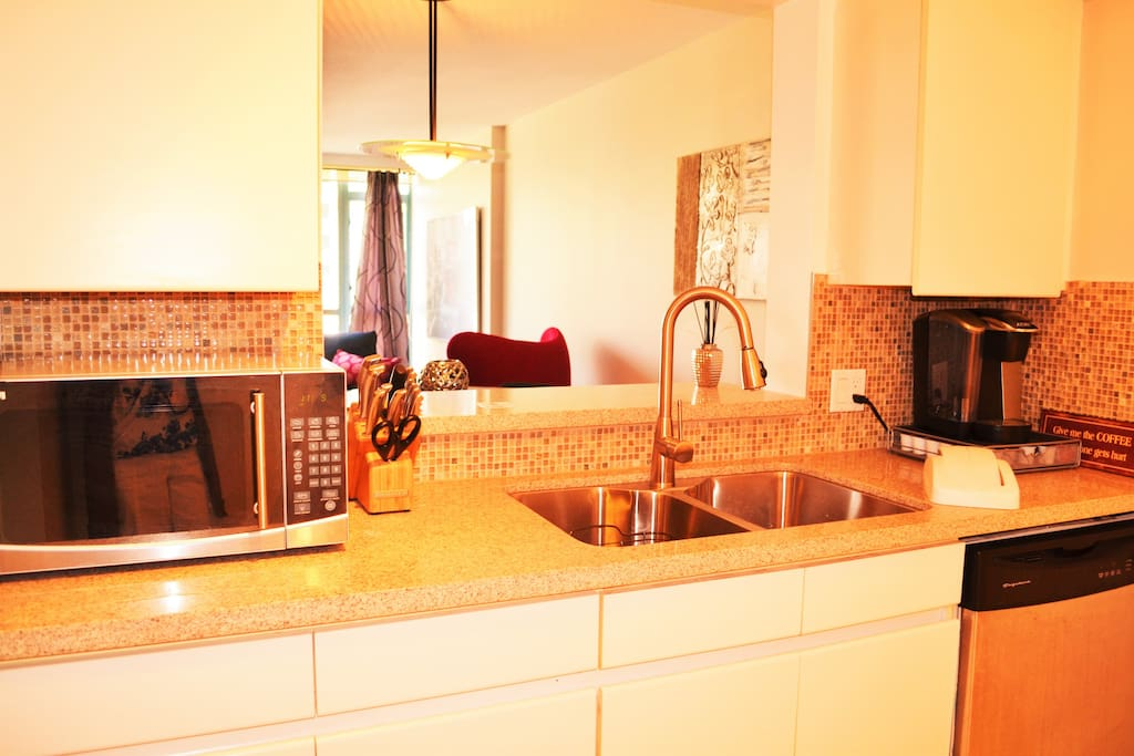Microwave, dishwasher, oven, stove and a beautiful backsplash make this kitchen a chef's dream.