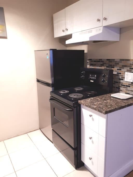 New refrigerator, stove & cupboards in kitchen