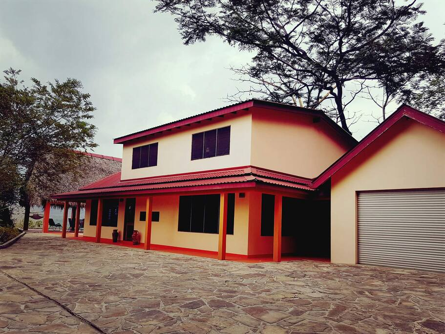 Brand new, 2-story villa set on a tropical hilltop with private garage.
