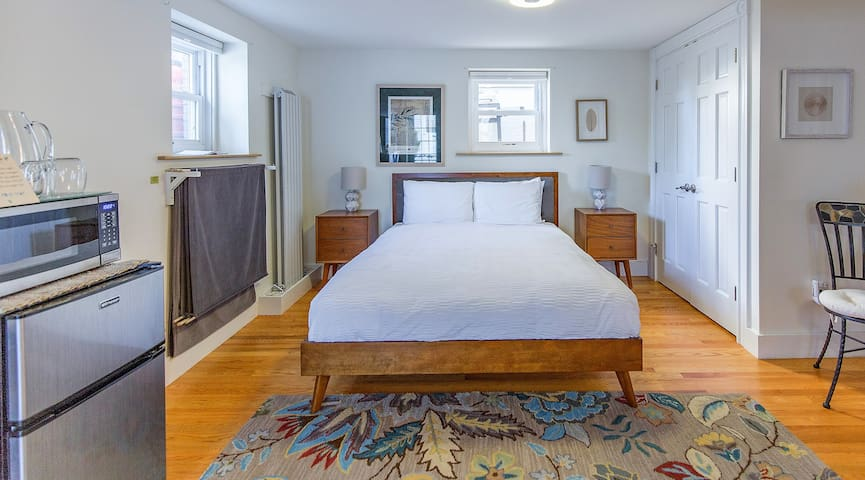 Queen size bed, organic mattress, and velvet room darkening shades if you want to sleep in.