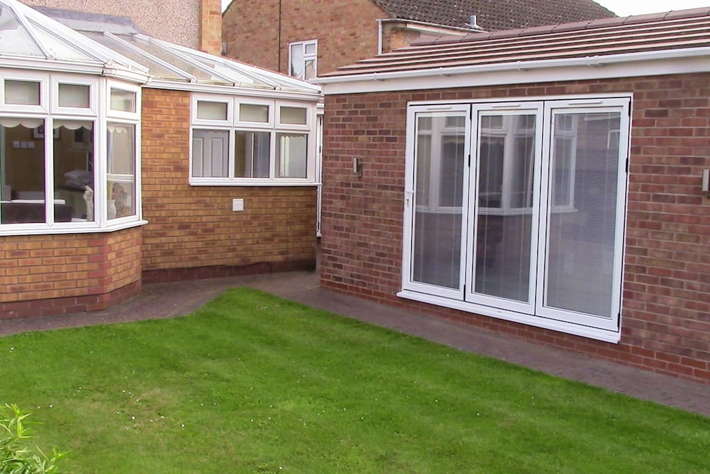 The annex which has bi folding doors looking out onto the garden