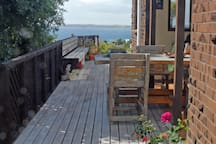 Deck and BBQ area on other side of house. Guests are welcome to use BBQ.