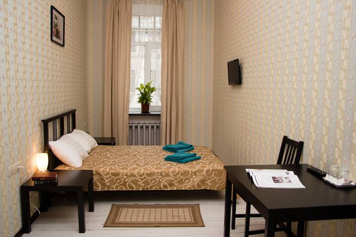 Room with shared bathroom in the city center - Sankt-Peterburg - Bed & Breakfast