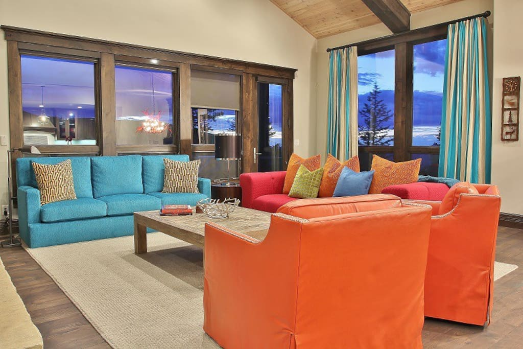 Living room with outside deck area and views of Empire Mountain and Park City in Lookout 28- Deer Valley