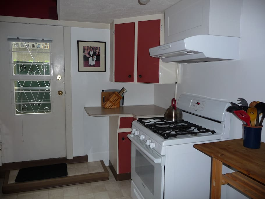 kitchen with sink, stove, oven and microwave