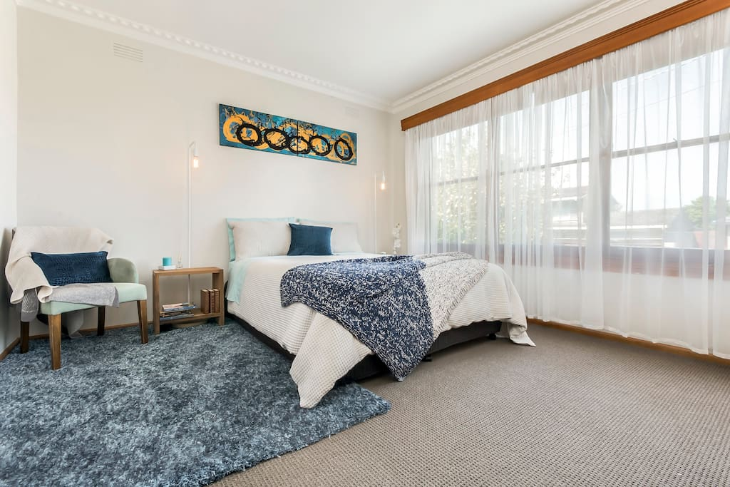 Spacious master, with Queen Bed and cozy linens and wardrobe storage space