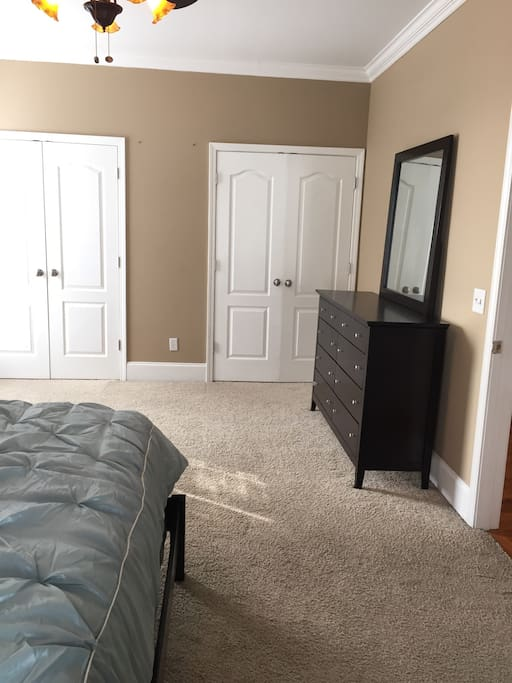 Two large closets and dresser.