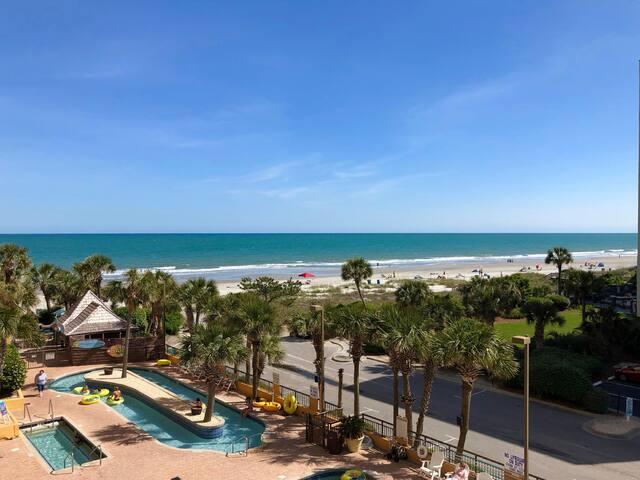 Open Air Arrival Ocean View with incredible SUNSETS. Relax in your home away from home. Full kitchen. Great Pools, Hot Tubs, Lazy River & More GJe7