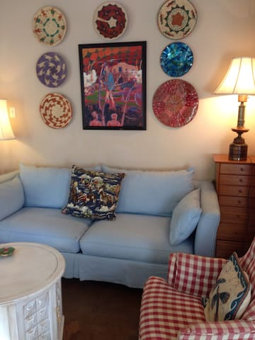 Living area has plenty of light and comfortable seating.