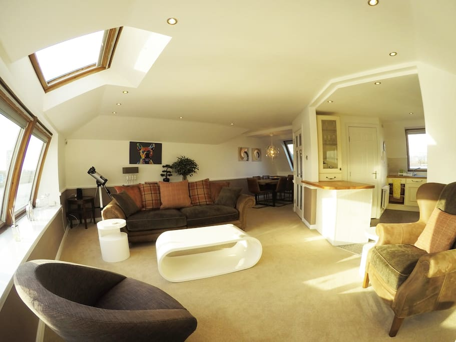 Spacious open plan lounge/living area.