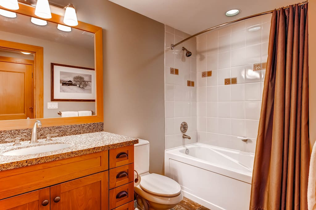 Bathroom with granite counters and plenty of space