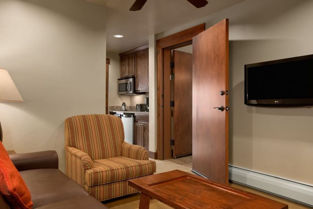 One bedroom Suite sitting area with galley kitchen area.