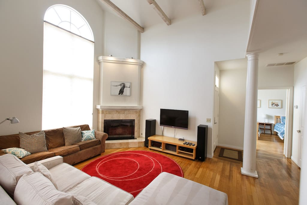 Large comfy sofas, cathedral ceilings, wood-burning fireplace, smart TV with cable
