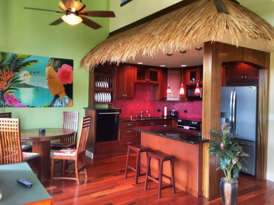 You'll love the style of this modern, fully equipped kitchen, featuring a palapa overhang.