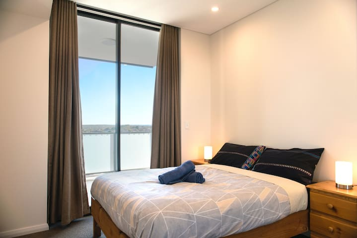 Bedroom with balcony has a double bed