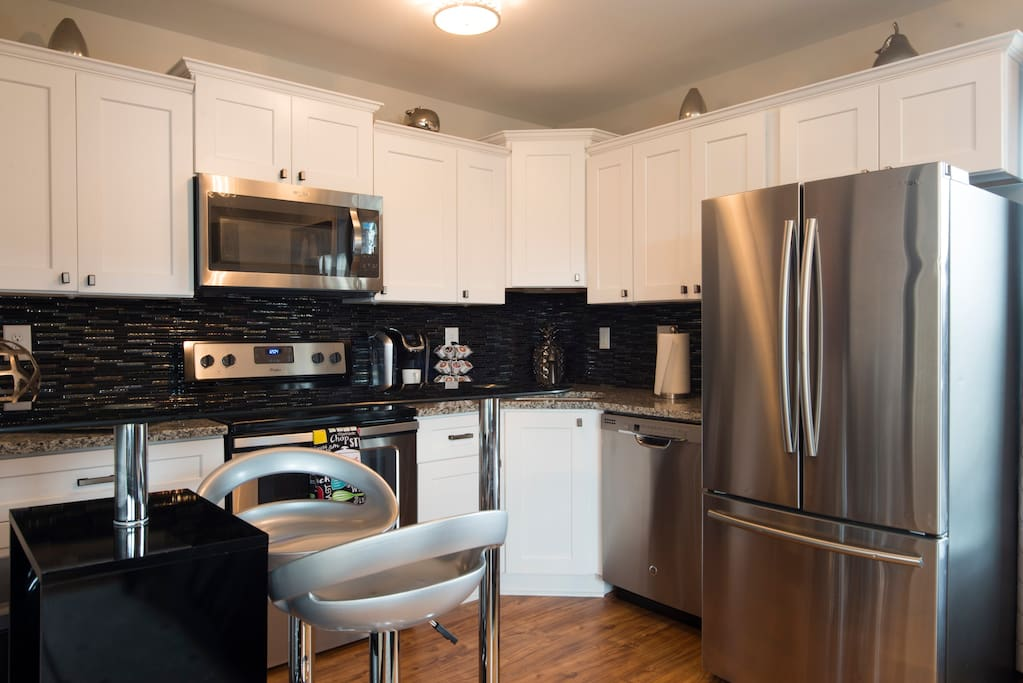 Full kitchen with Keurig, glasses, dishes, utensils, cookware, dishwasher...