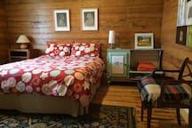 The beautiful cedar lined master bedroom.