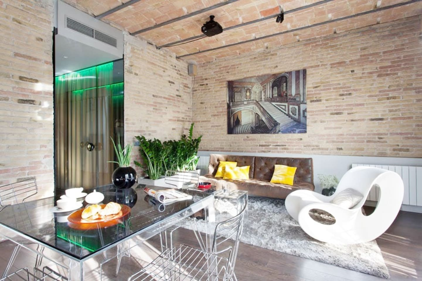 Stylish and bright living/dining area is perfect for working or socialising with friends and family
