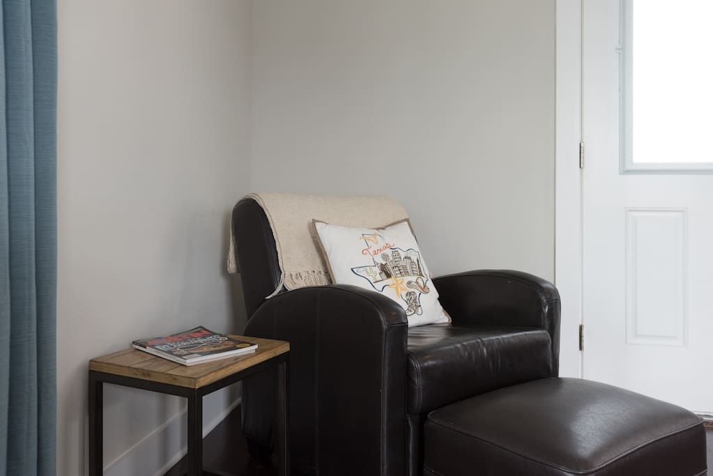 Cozy chair and ottoman makes a nice reading nook
