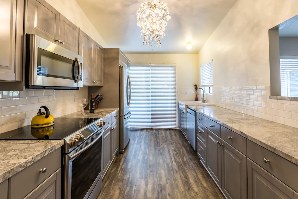 Gourmet kitchen has all new Samsung appliances, granite counter tops and is fully stocked for the aspiring chief.