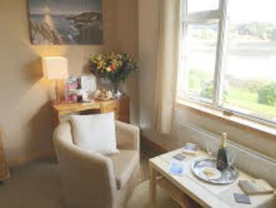Seating area in your room overlooking Loch Portree