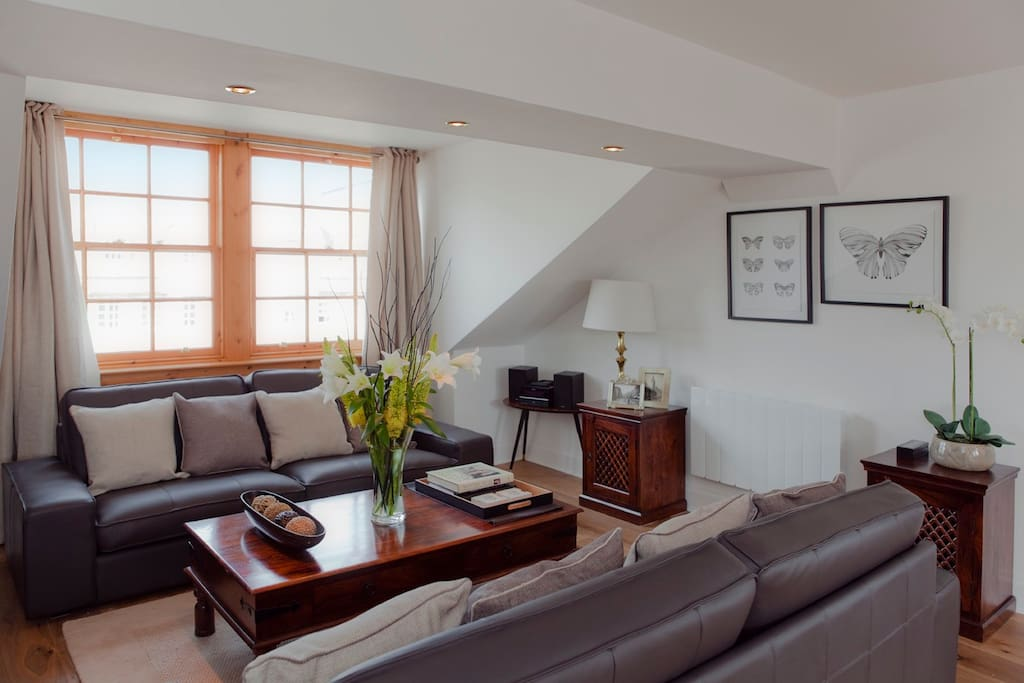 The bright and spacious living room.