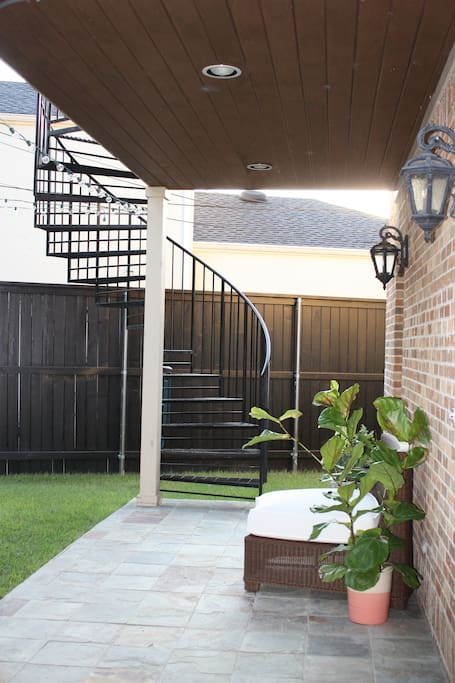 Sprial staircase leads to your own private patio.