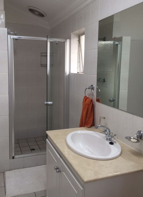 Bathroom is on suite with spacious shower.