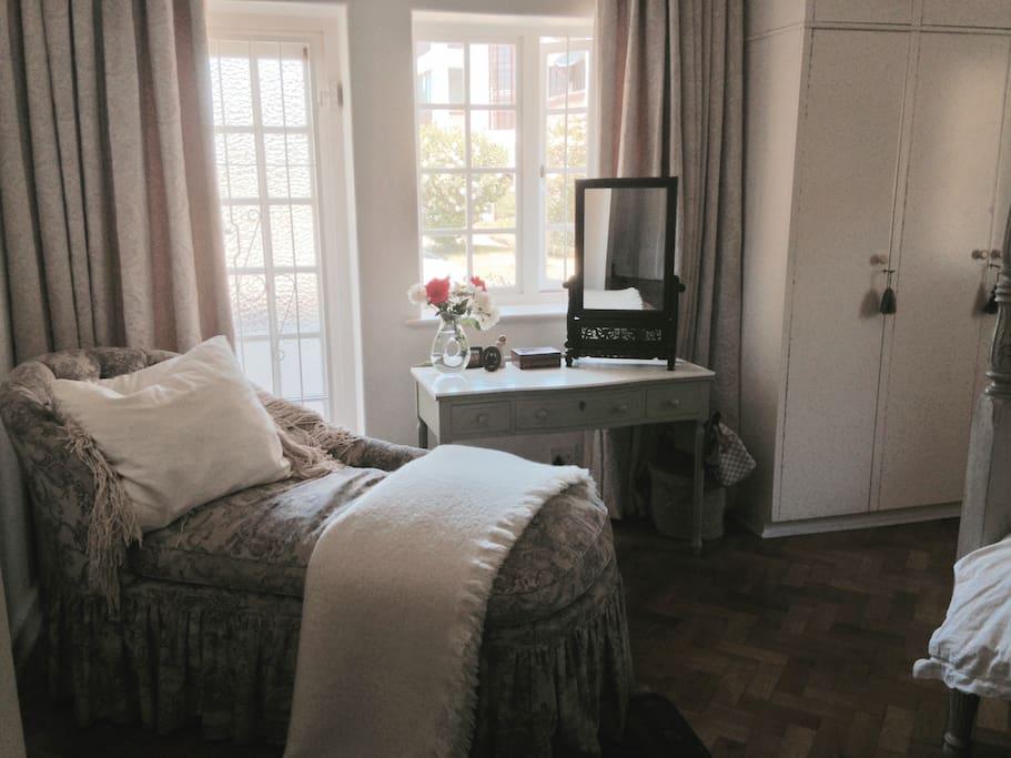Reading spot in main bedroom next to balcony