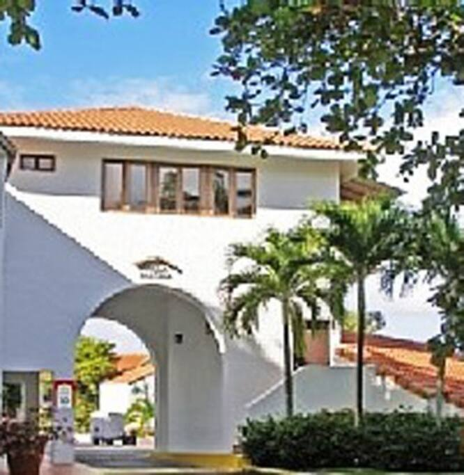 Situated over an elegant archway, this villa offers views in three different directions; the resort grounds, the ocean, and the National Rainforest.