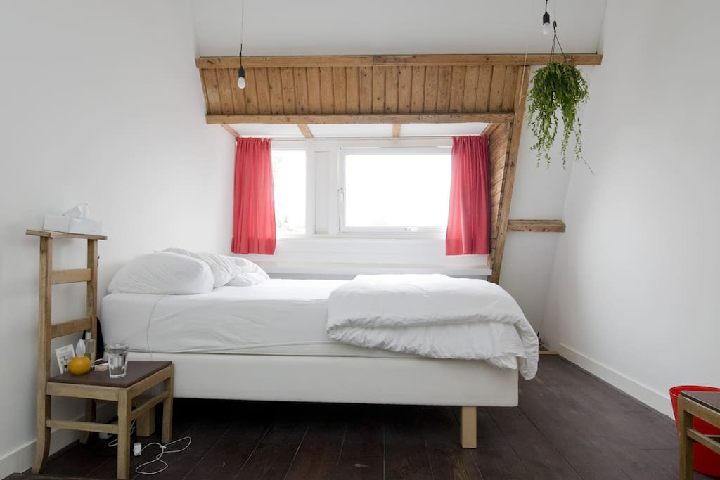 Romantic bedroom; right under the roof 4 meters above you.