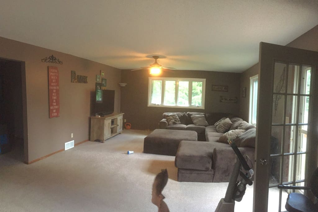 "Large family room with 60"" tv and giant sectional."
