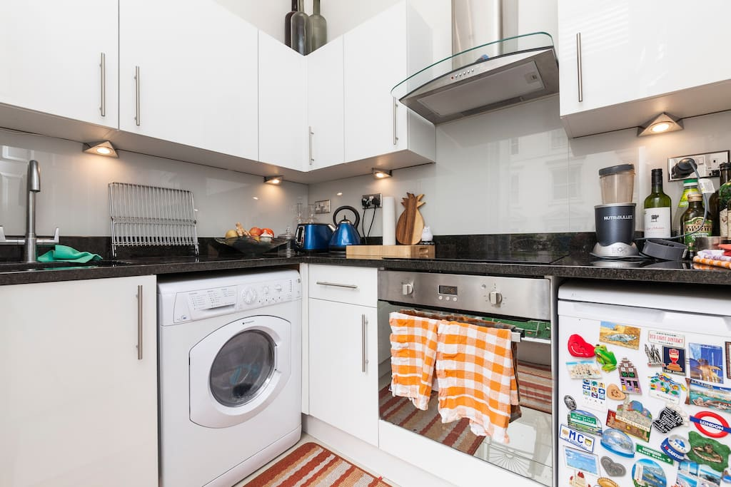 Separate kitchen area with direct access to private balcony and barbecue area.