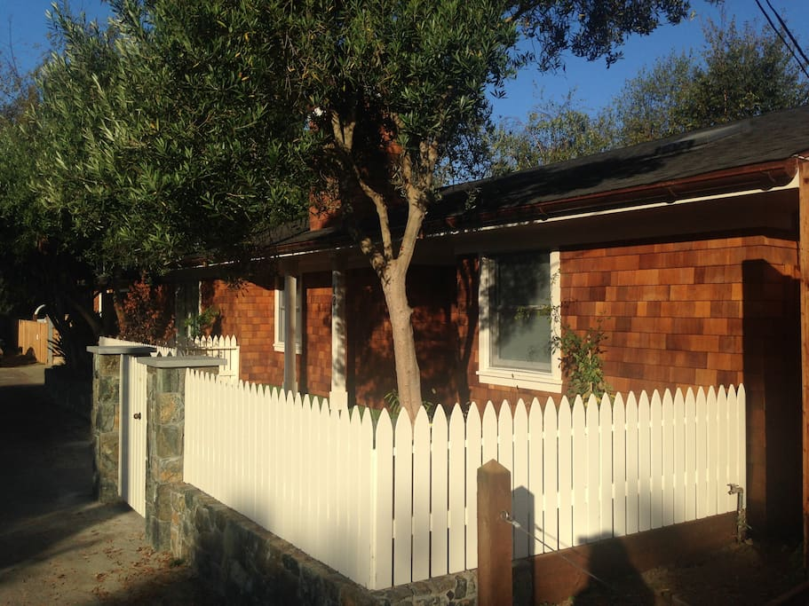 The house is so charming with its white picket fence.