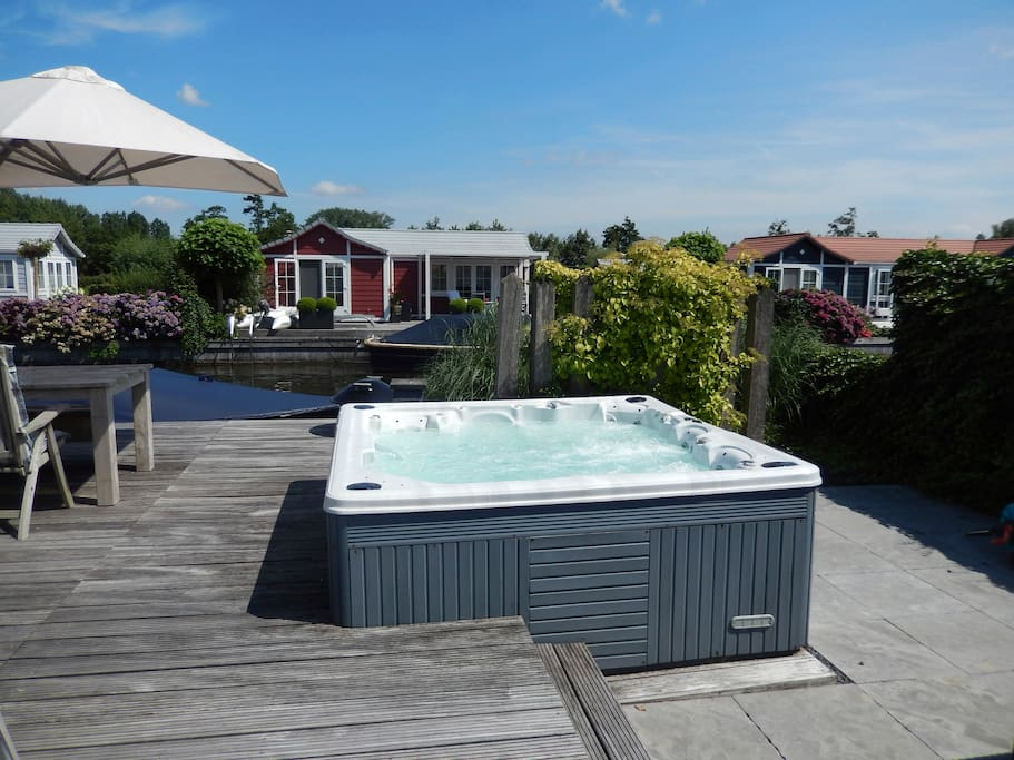 Enjoy our outdoor Jacuzzi , it fits 4-5 people.