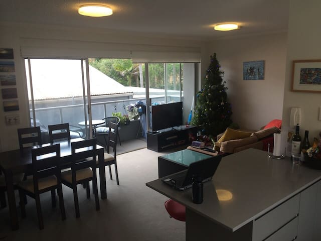 Lounge area looking into the balcony, also the dining room table